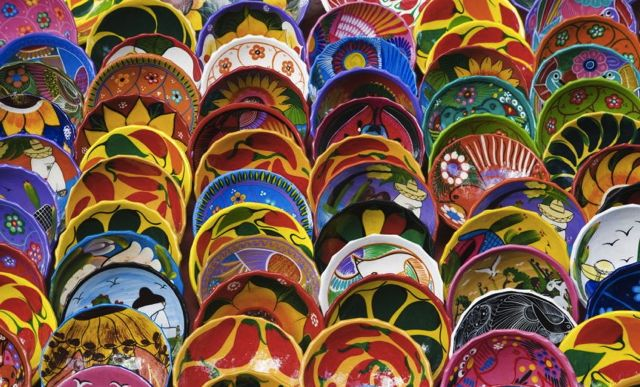 Colorful plates on display at a local store