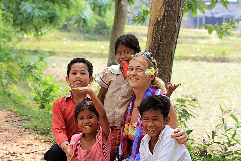An Interview With A Traveler   GlobeTrotterGirls.com - Dani with kids in Cambodia