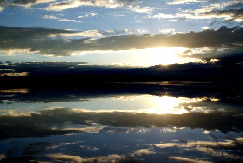 We arrived at Salar de Uyuni in Bolivia just as the sun was rising and making it through the clouds. The perfect reflection of the sky on the water covering the salt flats is to this day one of the most beautiful things I've ever seen.