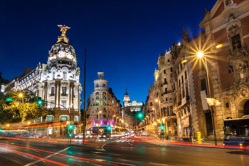 Pros and Cons of Long Term Travel as a Couple - SPAIN Madrid Shops at night