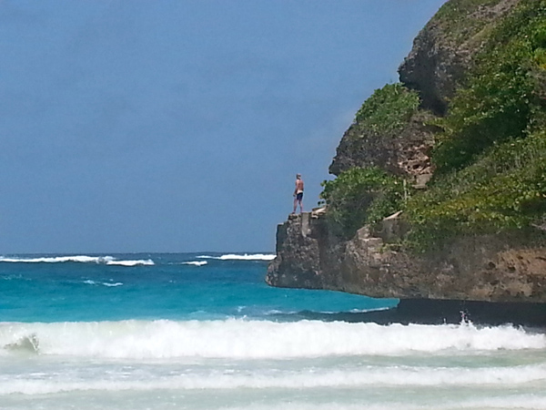 Escape the Winter, Head to the Sun - Barbados Carribean - Beach Man on Rocks