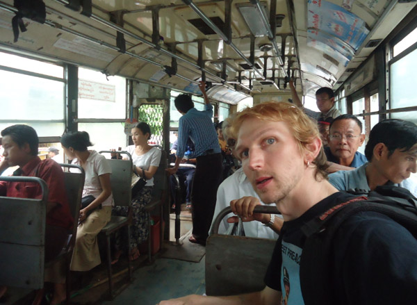 Jonny Blair backpacking on a local bus in Yangon Myanmar